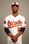 Alexi Casilla of the Baltimore Orioles poses during Photo Day on Saturday February 22 2014 at Ed Smith Stadium in Sarasota Florida