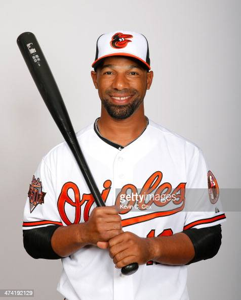 Alexi Casilla of the Baltimore Orioles poses for a portrait on photo day on February 22 2014 at Ed Smith Stadium in Sarasota Florida