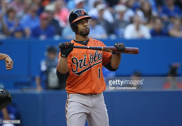 Alexi Casilla of the Baltimore Orioles reacts after striking out swinging in the eighth inning during MLB game action against the Toronto Blue Jays...