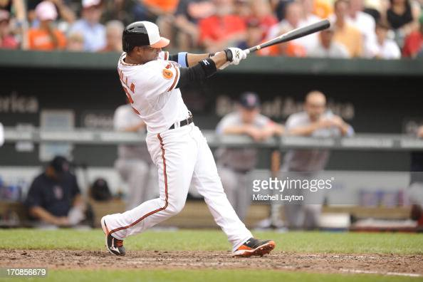 Alexi Casilla of the Baltimore Orioles takes a swing during a baseball game against the Boston Red Sox on June 16 2013 at Oriole Park at Camden Yards...