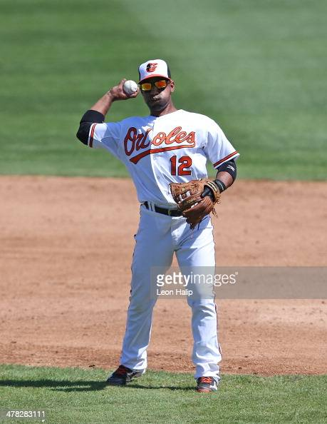 Alexi Casilla of the Baltimore Orioles warms up prior to the start of the third inning of the spring training game against the Boston Red Sox at Ed...