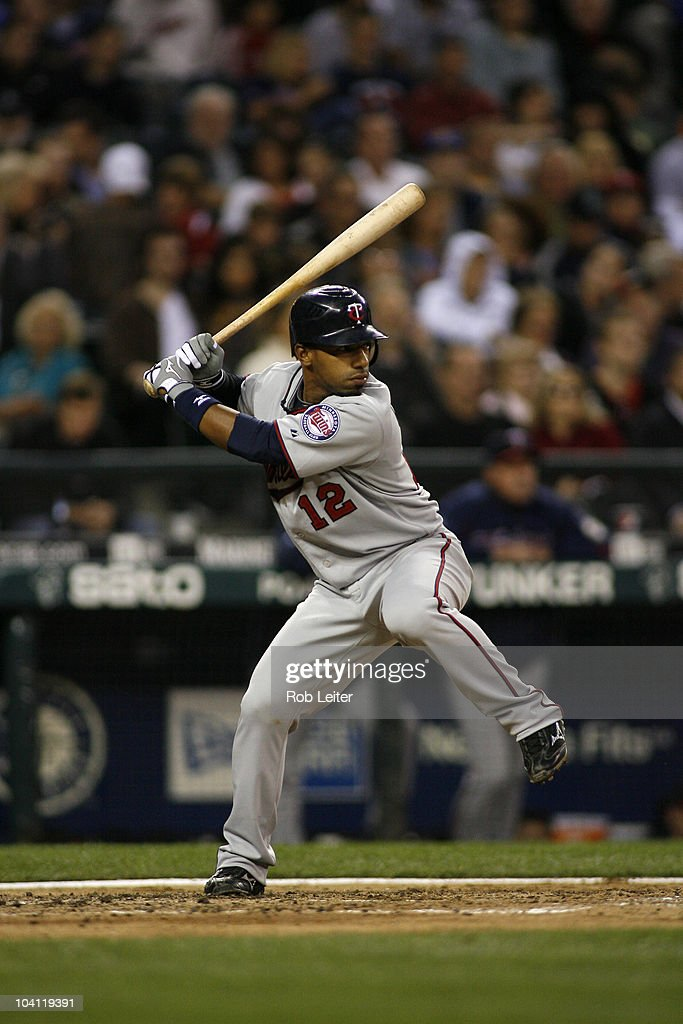 Alexi Casilla of the Minnesota Twins bats during the game against the Seattle Mariners at Safeco Field on August 27 2010 in Seattle Washington The...