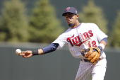 Alexi Casilla of the Minnesota Twins fields a ball hit by the Baltimore Orioles on May 9 2010 at Target Field in Minneapolis Minnesota The Twins won...