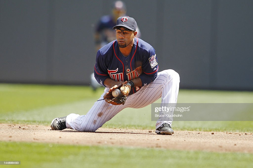Alexi Casilla of the Minnesota Twins fields a ball hit by the Cleveland Indians on May 15 2012 at Target Field in Minneapolis Minnesota The Indians...