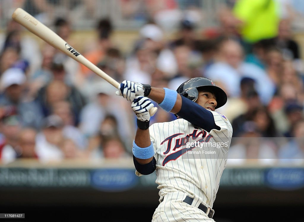 Alexi Casilla of the Minnesota Twins hits a solo home run against the San Diego Padres in the first inning on June 19 2011 at Target Field in...
