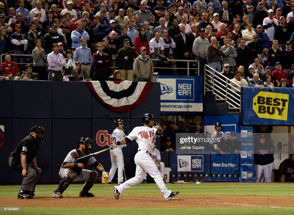 Alexi Casilla of the Minnesota Twins hits the gamewinning hit as the Twins defeat the Detroit Tigers to win the American League Tiebreaker game on...