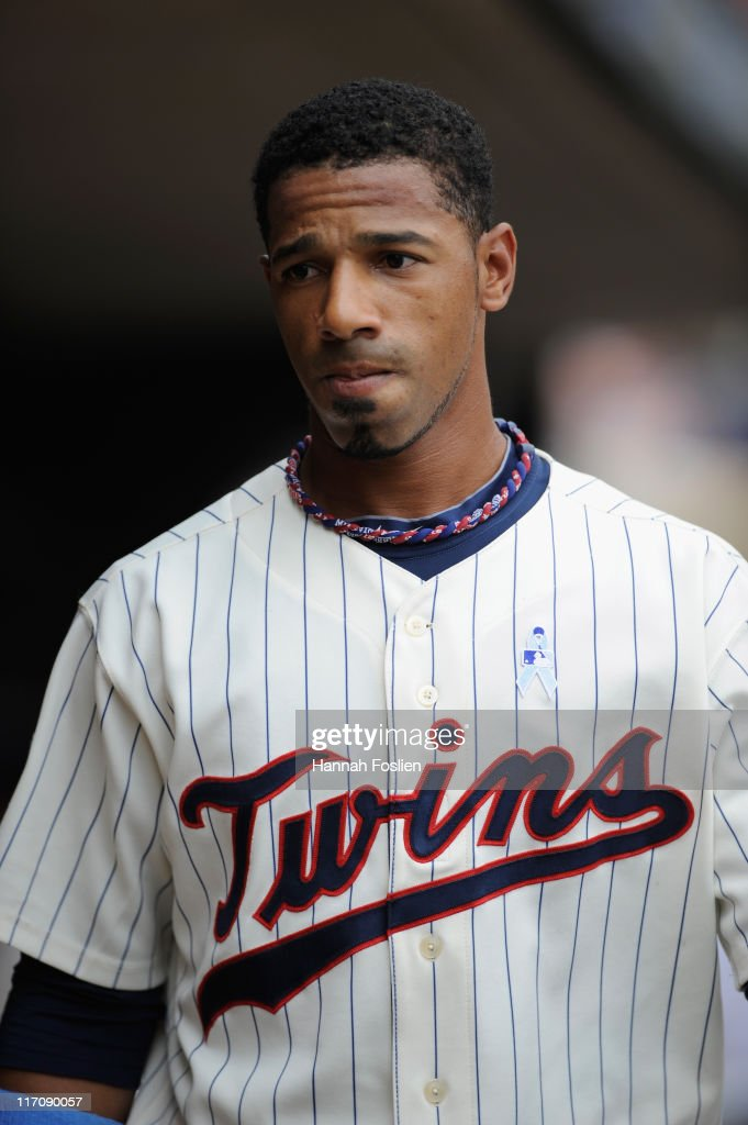 Alexi Casilla of the Minnesota Twins in the dugout during the game against the San Diego Padres on June 19 2011 at Target Field in Minneapolis...