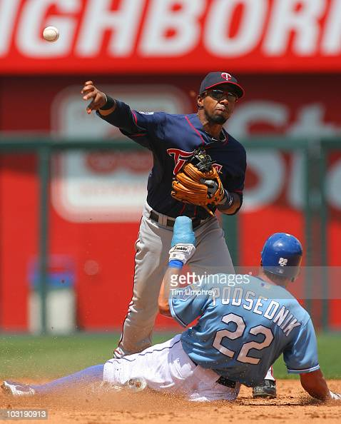Alexi Casilla of the Minnesota Twins throws to first base in a game against the Kansas City Royals on July 28 2010 at Kauffman Stadium in Kansas City...