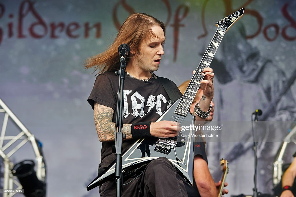 Alexi Laiho of Children of Bodom performs on stage at Bloodstock Open Air Festival at Catton Hall on August 9 2014 in Derby United Kingdom