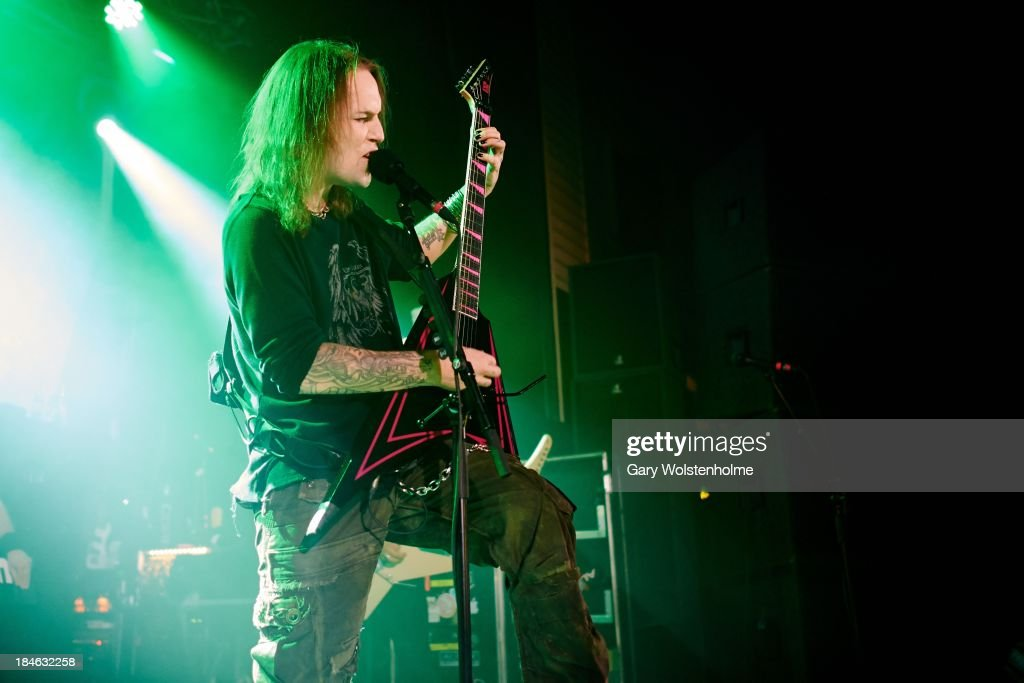 Alexi Laiho of Children Of Bodom performs on stage at Manchester Academy on October 14 2013 in Manchester England