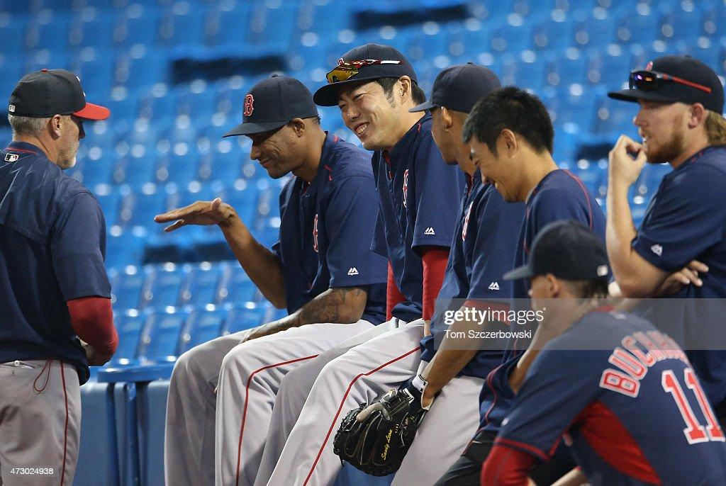 Alexi Ogando #41 and Koji Uehara #19 of the Boston Red Sox laugh before the start of MLB game action against the Toronto Blue Jays on May 9, 2015 at Rogers Centre in Toronto, Ontario, Canada.