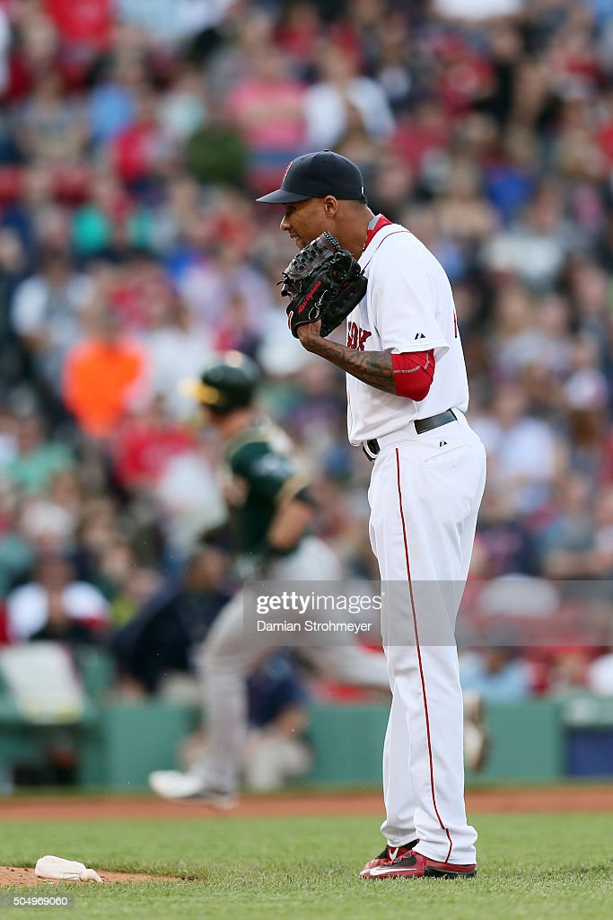 Alexi Ogando #41 of the Boston Red Sox reacts after giving up a home run to Mark Canha #20 of the Oakland Athletics during the game at Fenway Park on Saturday, June 6, 2015 in Boston, Massachusetts.