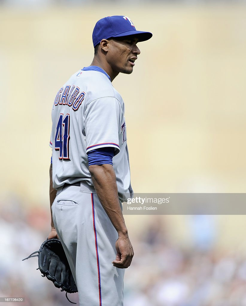 <a gi-track='captionPersonalityLinkClicked' href=/galleries/search?phrase=Alexi+Ogando&family=editorial&specificpeople=6889214 ng-click='$event.stopPropagation()'>Alexi Ogando</a> #41 of the Texas Rangers reacts to giving up a two run home run to Justin Morneau #33 of the Minnesota Twins during the sixth inning of the game on April 28, 2013 at Target Field in Minneapolis, Minnesota. The Twins defeated the Ranger 5-0.