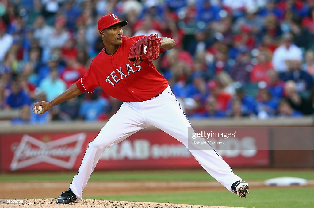 Alexi Ogando #41 of the Texas Rangers throws against the Boston Red Sox at Rangers Ballpark in Arlington on May 4, 2013 in Arlington, Texas.