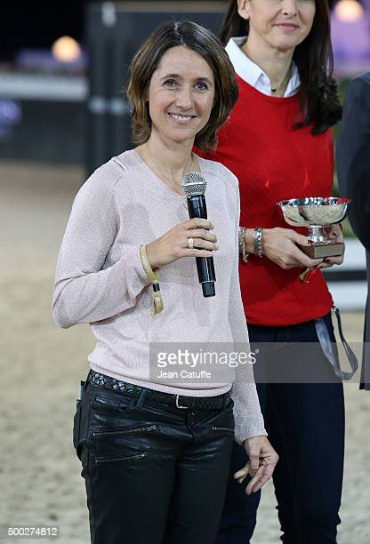 Alexia LarocheJoubert presents a trophy during day three of the Longines Paris Masters 2015 held at the ParisNord Villepinte Exhibition Center on...