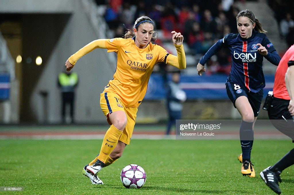 Alexia Putellas of Barcelona and Erika of PSG during Uefa Women's Champions League match between Paris Saint Germain and Fc Barcelona round of 8...