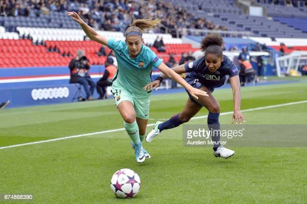 Alexia Putellas of Barcelona and Laura Georges of Paris SaintGermain fight for the ball during the Women's Champions League match between Paris Saint...