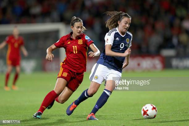 Alexia Putellas of Spain and Caroline Weir of Scotland battle for possession during the Group D match between Scotland and Spain during the UEFA...