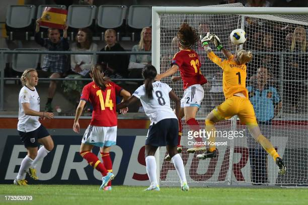 Alexia Putellas of Spain scores the third and decision goal against Karen Bardsley of England during the UEFA Women's EURO 2013 Group C match between...