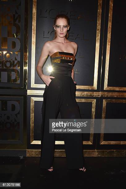 Alexina Graham attends the Gold Obsession Party L'Oreal Paris Photocall as part of the Paris Fashion Week Womenswear Spring/Summer 2017 on October 2...