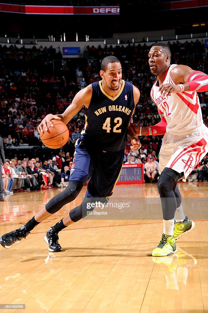 Alexis Ajinca #42 of the New Orleans Pelicans drives against the Houston Rockets on April 12, 2014 at the Toyota Center in Houston, Texas.