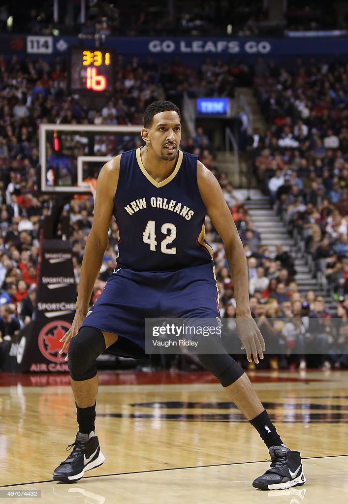 Alexis Ajinca #42 of the New Orleans Pelicans has #PrayForParis written on his shoe during an NBA game against the Toronto Raptors at the Air Canada Centre on November 13, 2015 in Toronto, Ontario, Canada.