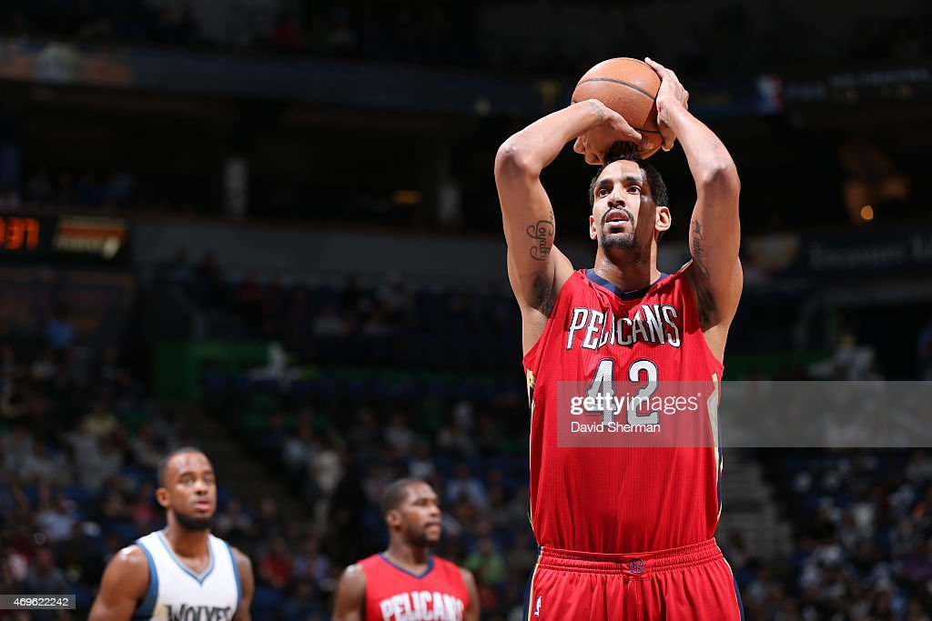 Alexis Ajinca #42 of the New Orleans Pelicans shoots against the Minnesota Timberwolves during the game on April 13, 2015 at Target Center in Minneapolis, Minnesota.