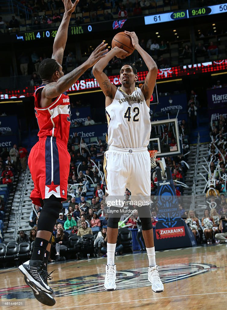 Alexis Ajinca #42 of the New Orleans Pelicans shoots the ball against the Washington Wizards during an NBA game on January 8, 2014 at the New Orleans Arena in New Orleans, Louisiana.