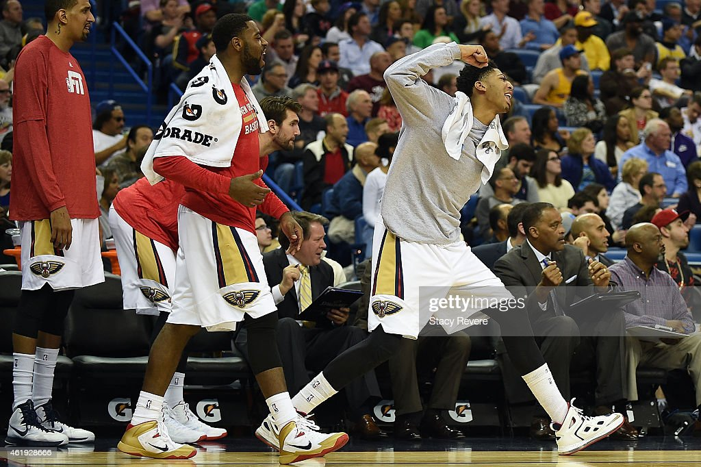 Alexis Ajinca #42, Tyreke Evans #1 and Anthony Davis #23 of the New Orleans Pelicans react to a score during a game against the Los Angeles Lakers at the Smoothie King Center on January 21, 2015 in New Orleans, Louisiana.