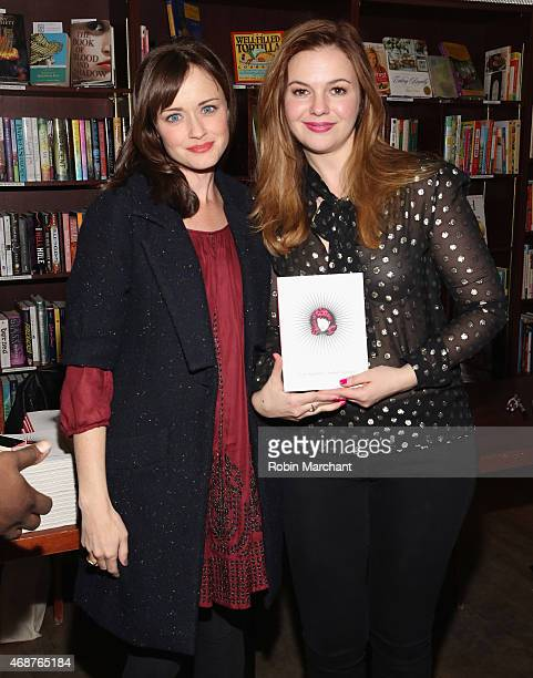 Alexis Bledel and Amber Tamblyn attend Amber Tamblyn 'Dark Sparkler' Book Release Party at Housing Works Bookstore Cafe on April 6 2015 in New York...