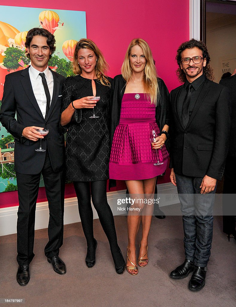Alexis Bonte, Eva Dichand and Lorenzo Fiaschi attend Mimi Foundation 'The Power of Love' gala dinner and auction at Sotheby's on October 16, 2013 in London, England.