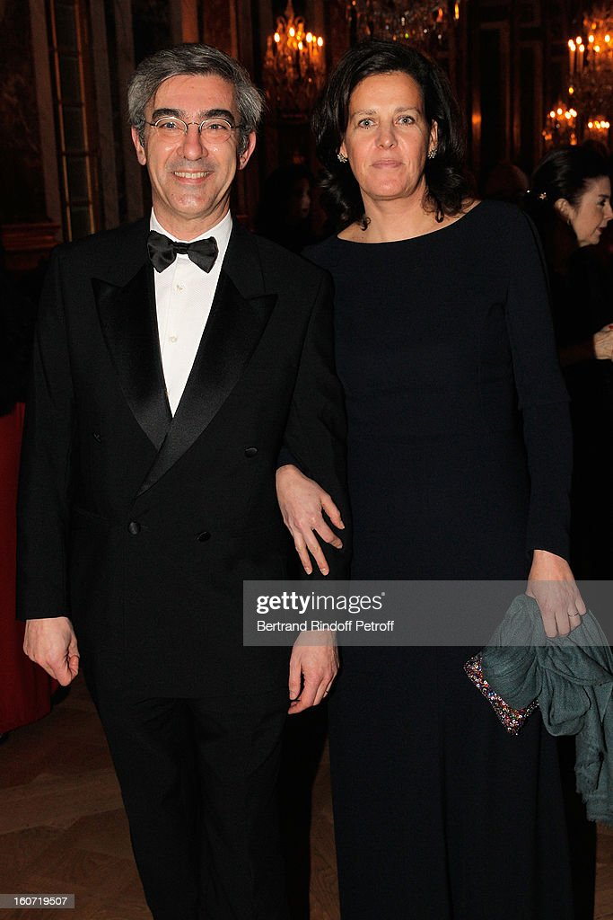Alexis Brezet (L) and his wife attend the gala dinner of Professor David Khayat's association 'AVEC', at Chateau de Versailles on February 4, 2013 in Versailles, France.