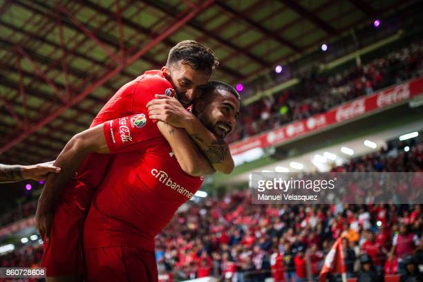Alexis Canelo of Toluca celebrates with teammate Maximiliano Perg of Toluca after scoring the first goal of his team during the 13th round match...