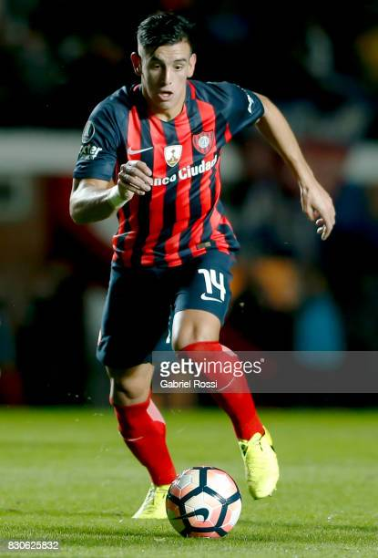 Alexis Castro of San Lorenzo drives the ball during a second leg match between San Lorenzo and Emelec as part of round of 16 of Copa CONMEBOL...
