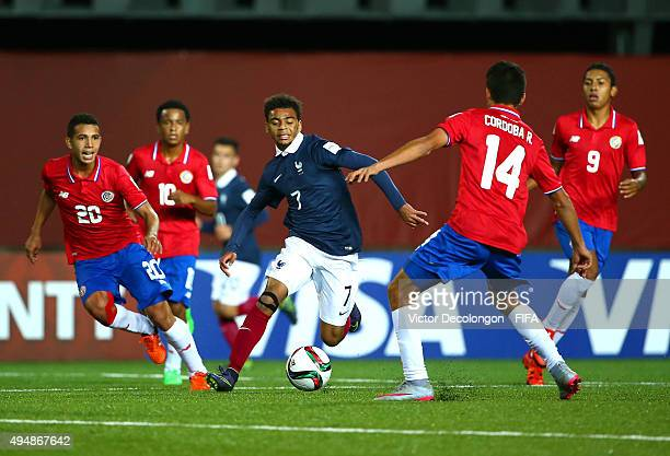 Alexis Claude Maurice of France dribbles the ball through the Costa Rica defense during the France v Costa Rica Round of 16 FIFA U17 World Cup Chile...