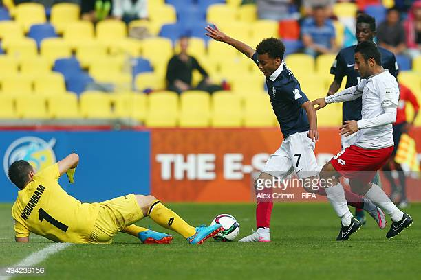 Alexis Claude Maurice of France is challenged by goalkeeper William Ghannam and Ahmad Alkhassi of Syria during the FIFA U17 World Cup Chile 2015...