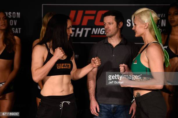 Alexis Davis and Cindy Dandois of Belgium face off during the UFC Fight Night weighin at the Sheraton Music City Hotel on April 21 2017 in Nashville...