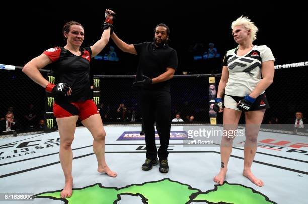 Alexis Davis celebrates after defeating Cindy Dandois of Belgium in their women's bantamweight bout during the UFC Fight Night event at Bridgestone...