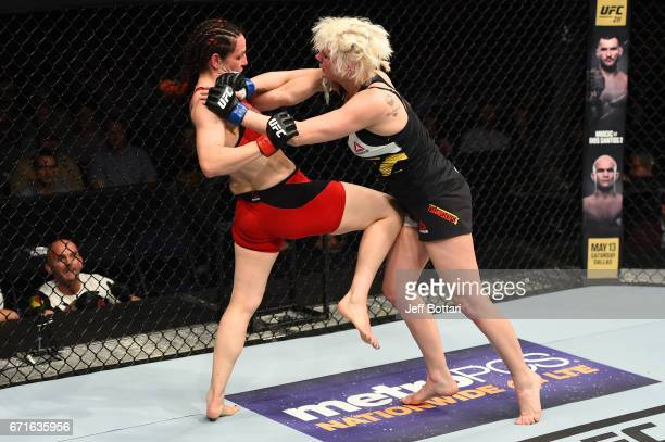 Alexis Davis knees Cindy Dandois of Belgium in their women's bantamweight bout during the UFC Fight Night event at Bridgestone Arena on April 22 2017...