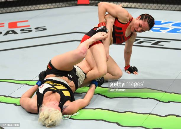 Alexis Davis of the Canada attempts to secure a leg lock against Cindy Dandois of Belgium in their women's bantamweight bout during the UFC Fight...