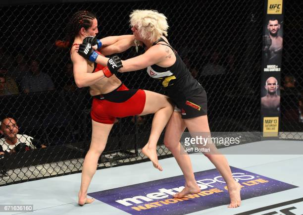 Alexis Davis of the Canada knees Cindy Dandois of Belgium in their women's bantamweight bout during the UFC Fight Night event at Bridgestone Arena on...