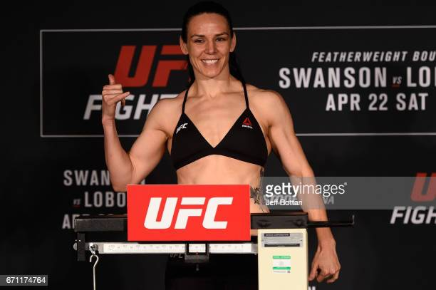 Alexis Davis poses on the scale during the UFC Fight Night weighin at the Sheraton Music City Hotel on April 21 2017 in Nashville Tennessee