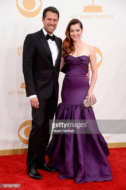 Alexis Denisof and Alyson Hannigan arrive at the 65th Annual Primetime Emmy Awards held at Nokia Theatre LA Live on September 22 2013 in Los Angeles...