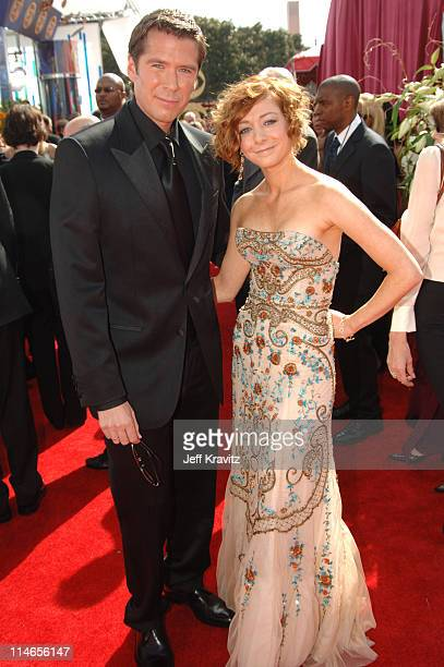 Alexis Denisof and Alyson Hannigan during 57th Annual Primetime Emmy Awards Red Carpet at The Shrine in Los Angeles California United States