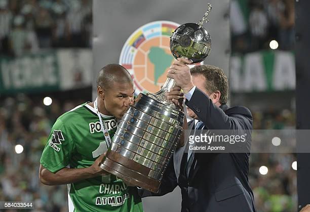 Alexis Henriquez captain of Nacional receives and kisses the trophy as champion of the Copa Libertadores 2016 after a second leg final match between...