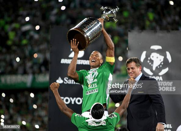 Alexis Henriquez of Atletico Nacional celebrates with the trophy after a second leg final match between Atletico Nacional and Independiente del Valle...