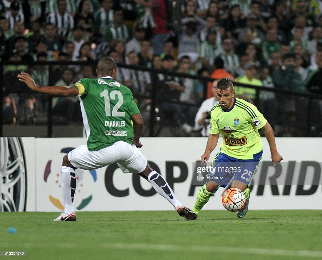 Alexis Henriquez player of Nacional (L) vies for the ball with Gabriel Costa of Sporting Cristal (R) during a group stage match between Atletico Nacional and Sporting Cristal as part of Copa Libertadores 2016 at Atanasio Girardot Stadium on March 01, 2016 in Medellin, Colombia.