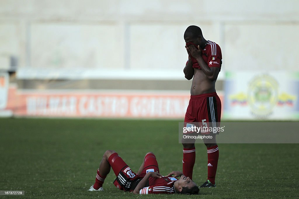 Alexis Hinestroza and Angelo Pena of Caracas FC during a match between Llaneros de Guanare and Caracas FC as part of the Clausura Tournament 2013 at the Estadio Olimpico Rafael Calles Pinto on April 24, 2013 in Guanare, Venezuela.