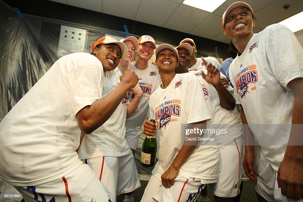 Alexis Hornbuckle Deanna Nolan and Plenette Pierson of the Detroit Shock celebrates in the lockerroom after winning Game Three of the WNBA Finals...