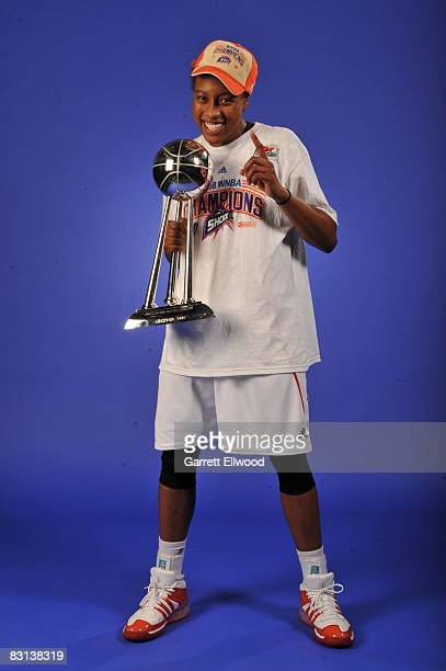 Alexis Hornbuckle of the Detroit Shock poses for a portrait with the trophy after winning Game Three of the WNBA Finals against the San Antonio...